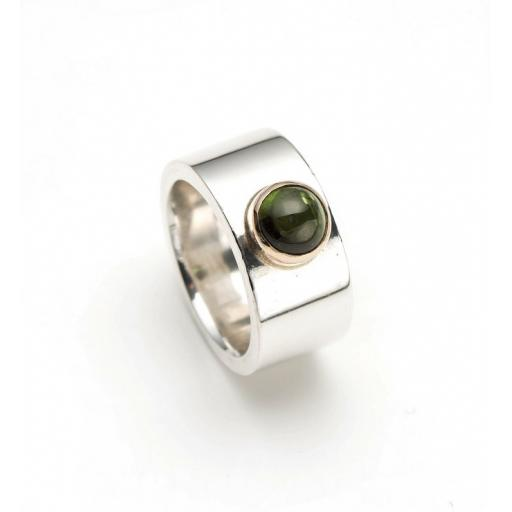Beautifully solid Sterling Silver Ring with a green Tourmaline, set in 9ct Yellow Gold