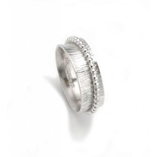 Hand made Sterling Silver 'Bark' textured 'Spinning' Ring with beaded, Sterling Silver 'spinner'.