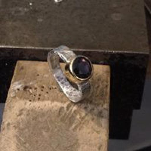 Sterling Silver Ring using our customer's own stone, set into 9ct Yellow Gold.