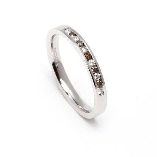 Hand made in either 18ct White or Yellow gold, a half eternity ring, channel set with white and chocolate diamonds.