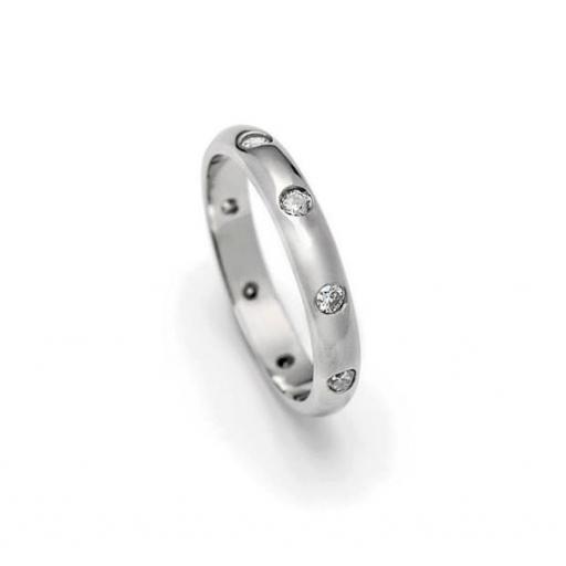 Handmade Platinum full eternity or wedding band with 9 flush set diamonds.